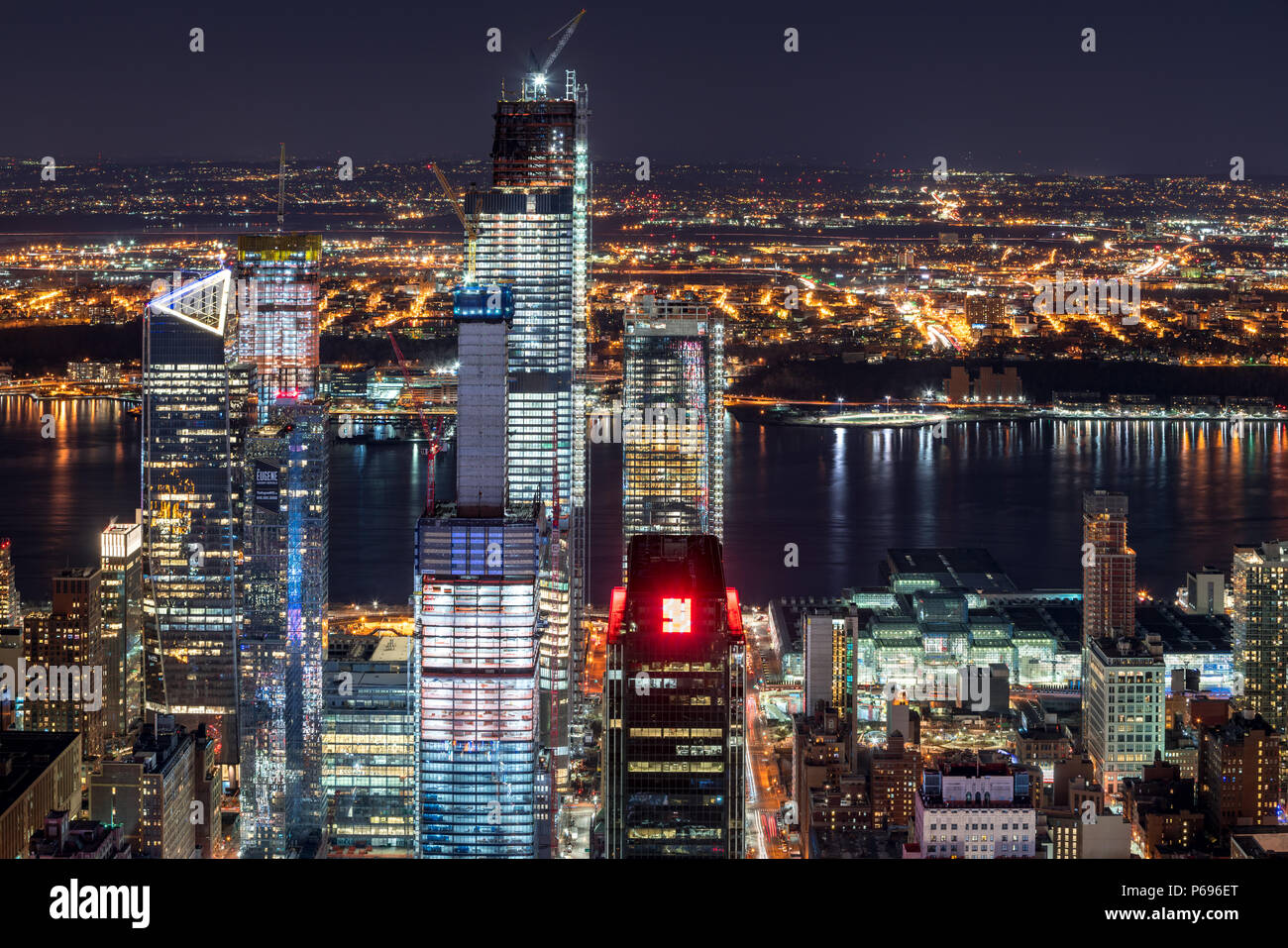 New York City, NY, USA - Mach 11, 2018: Night aerial view of Hudson Yards skyscrapers under contruction with the Hudson River. Chelsea, Manhattan - Stock Image
