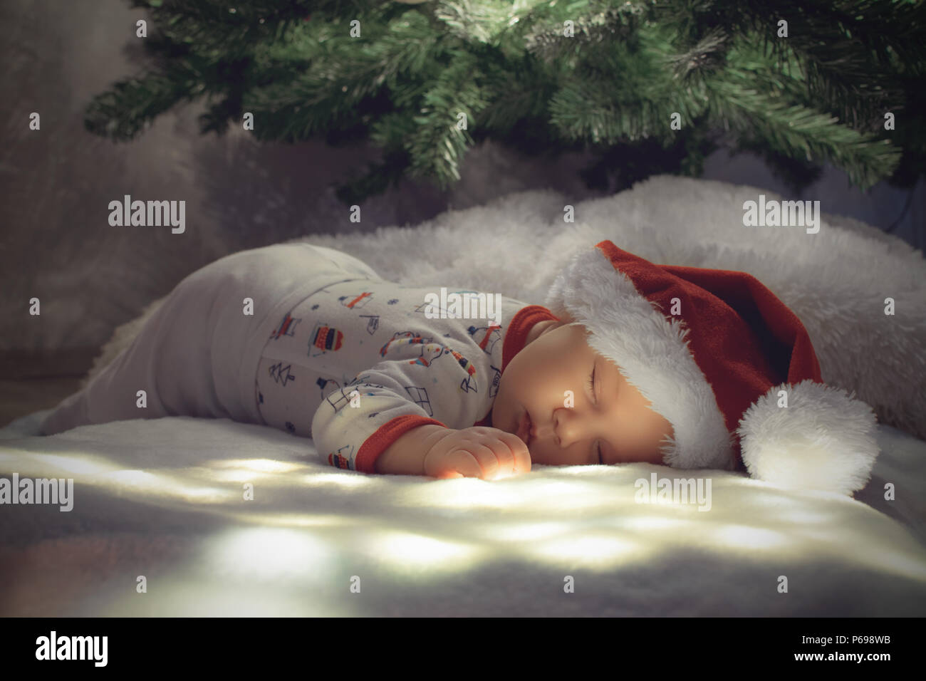 Newborn Christmas Pictures.Newborn Baby Boy Sleep Under Christmas Tree On White