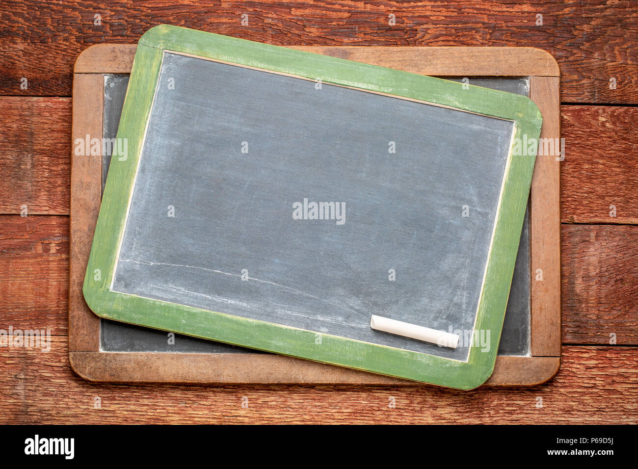 blank slate blackboards with a chalk against rustic barn wood - Stock Image