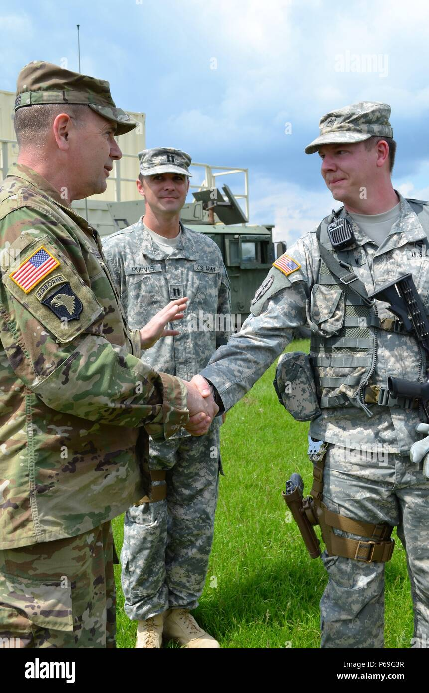 Lt Gen Ben Hodges Commanding General Of U S Army Europe Commends Sgt Nathan Kersten 1165th Military Police Company Alabama National Guard By Presenting Him With A Commander S Coin Sgt Kersten Was Recognized