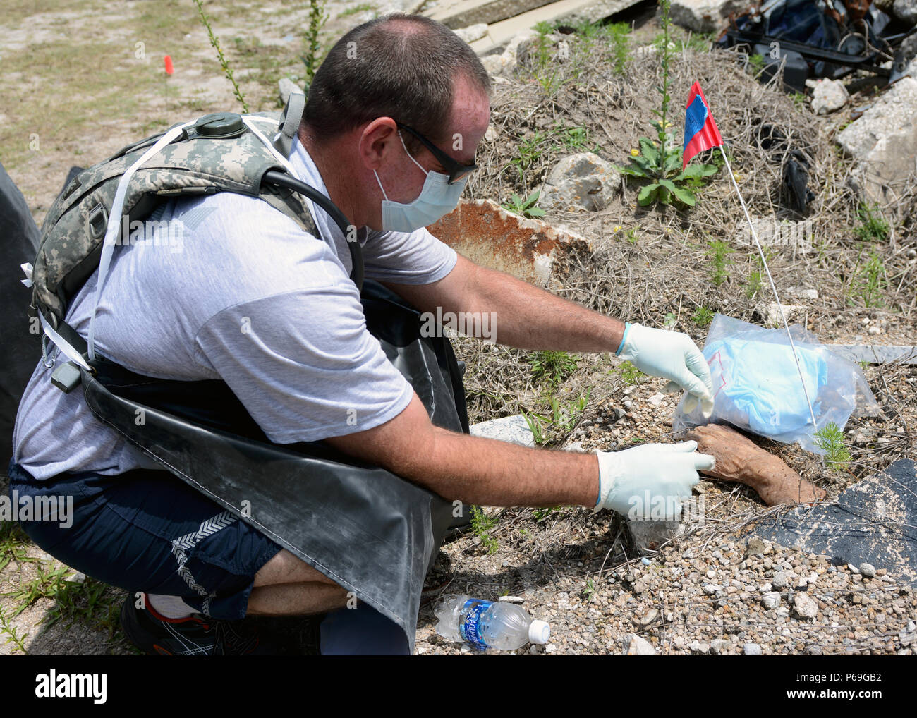 U.S. Air Force Tech. Sgt. Ethan Barnas prepares for the collection of a severed human hand cadaver during the Florida Emergency Mortuary Operations Response System (FEMORS) Hurricane Exercise (HUREX) Drill at Camp Blanding Joint Training Center in Starke, Fla., on May 18, 2016.The FEMORS HUREX Drill was an first of its kind operational drill designed to establish a learning environment for FEMORS, District Medical Examiner offices (District 4 and District 8), the Florida CBRNE Enhanced Response Force Package (CERFP) and 254th Transportation Company to exercise emergency response plans, policie Stock Photo