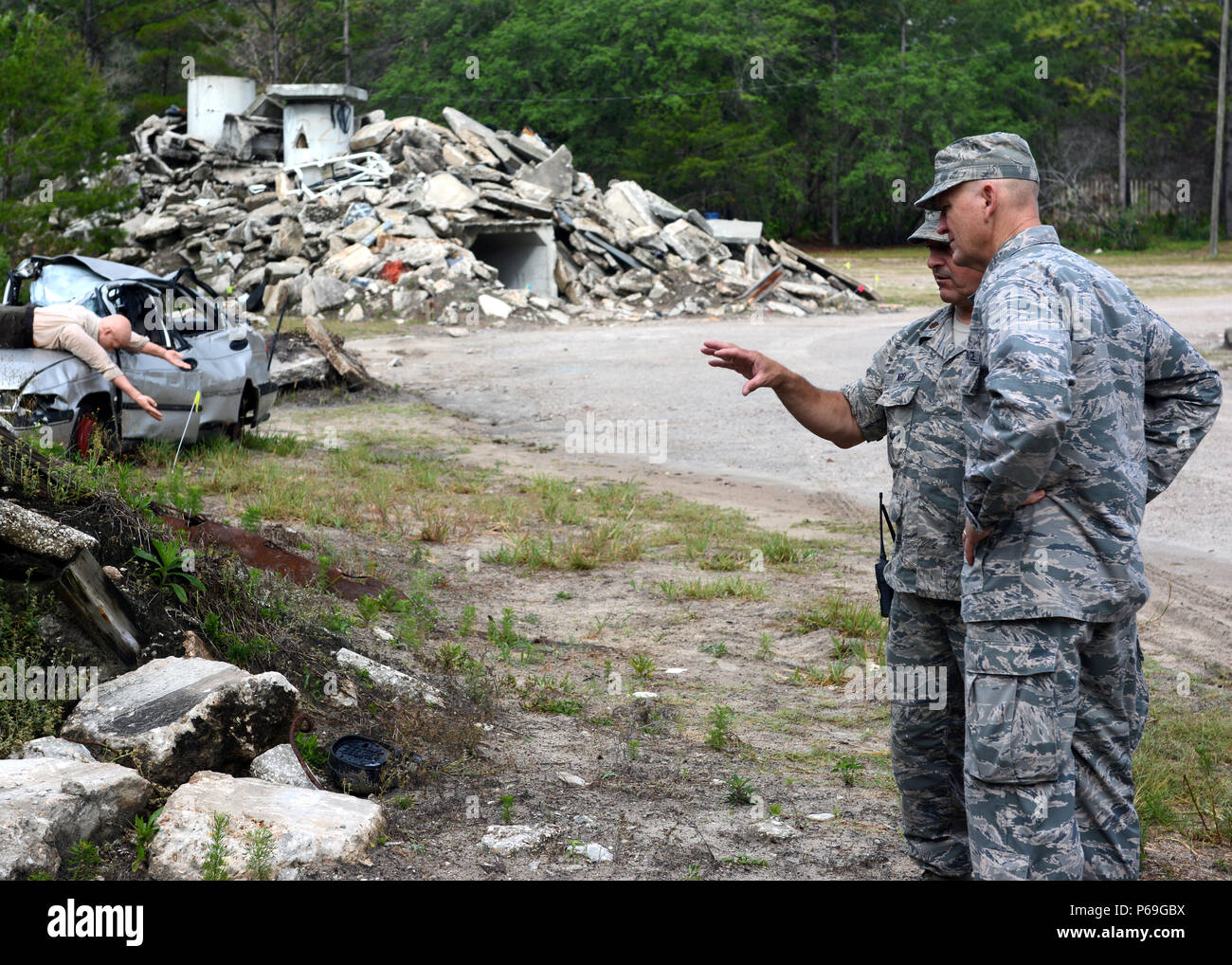 U.S. Air Force Maj. Robert Ard (left) explains the level of complexity in preparation and setup of the Florida Emergency Mortuary Operations Response System (FEMORS) Hurricane Exercise (HUREX) to Brig. Gen. James Eifert, Commander, Florida Air National Guard, at Camp Blanding Joint Training Center in Starke, Fla., on May 19, 2016.The FEMORS HUREX Drill was an first of its kind operational drill designed to establish a learning environment for FEMORS, District Medical Examiner offices (District 4 and District 8), the CERFP and 254th Transportation Company to exercise emergency response plans, p Stock Photo