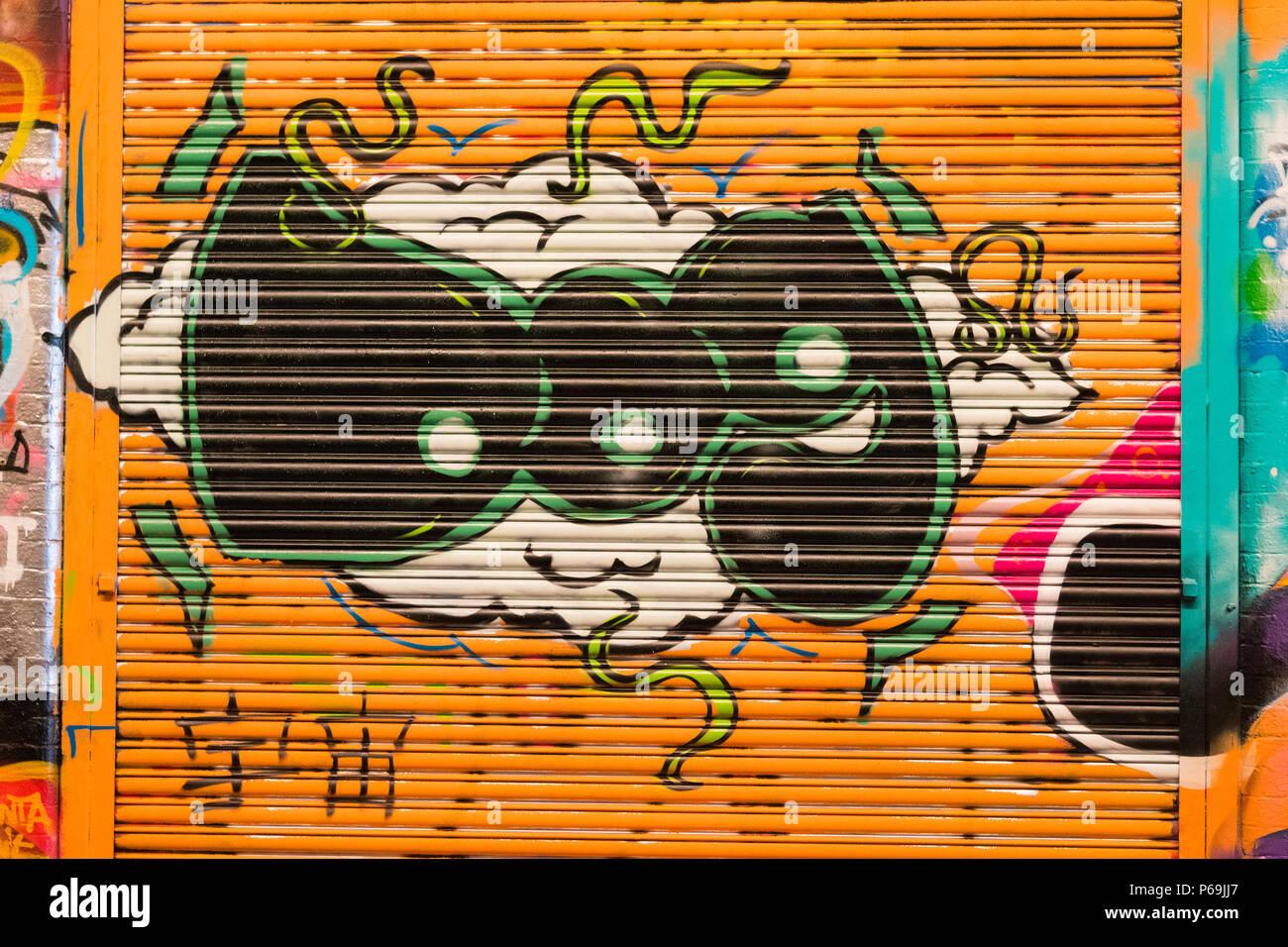 London Waterloo Leake Street graffiti letters DOG on cloud on orange roller shutter - Stock Image