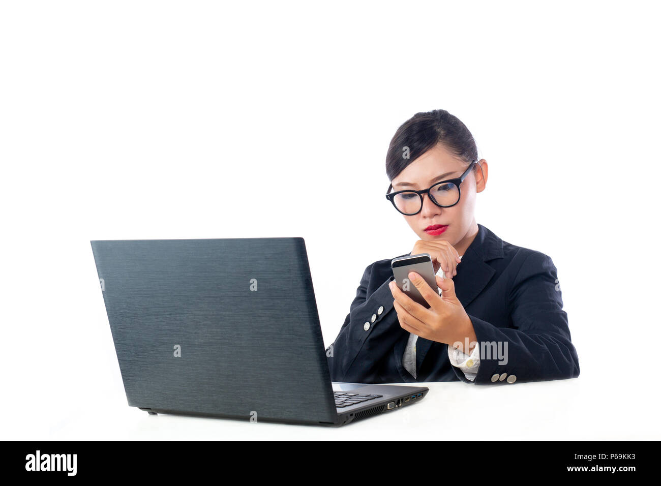 Business woman looking at the phone, analyzing the white background. Stock Photo