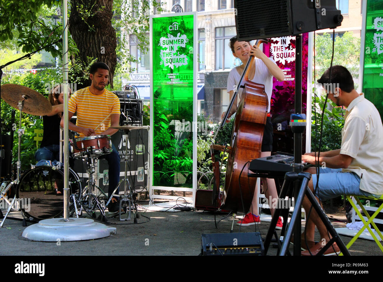 NEW YORK, NY - JUNE 22: Jazz trio performs live as a part of Summer in the Square free activities in Union Square in Lower Manhattan on JUNE 22th, 201 - Stock Image
