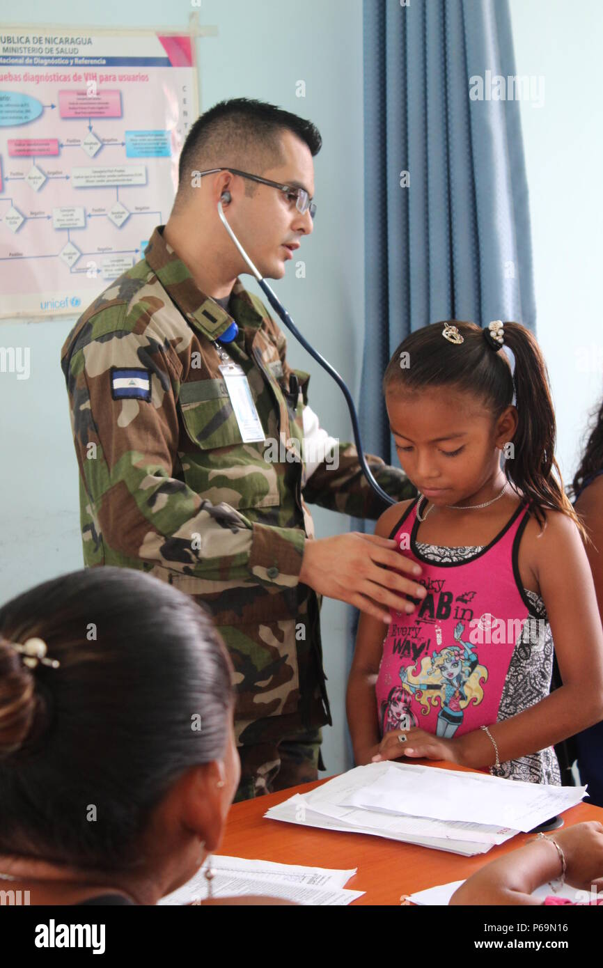 A Nicaraguan Army pediatrician examines a young girl during