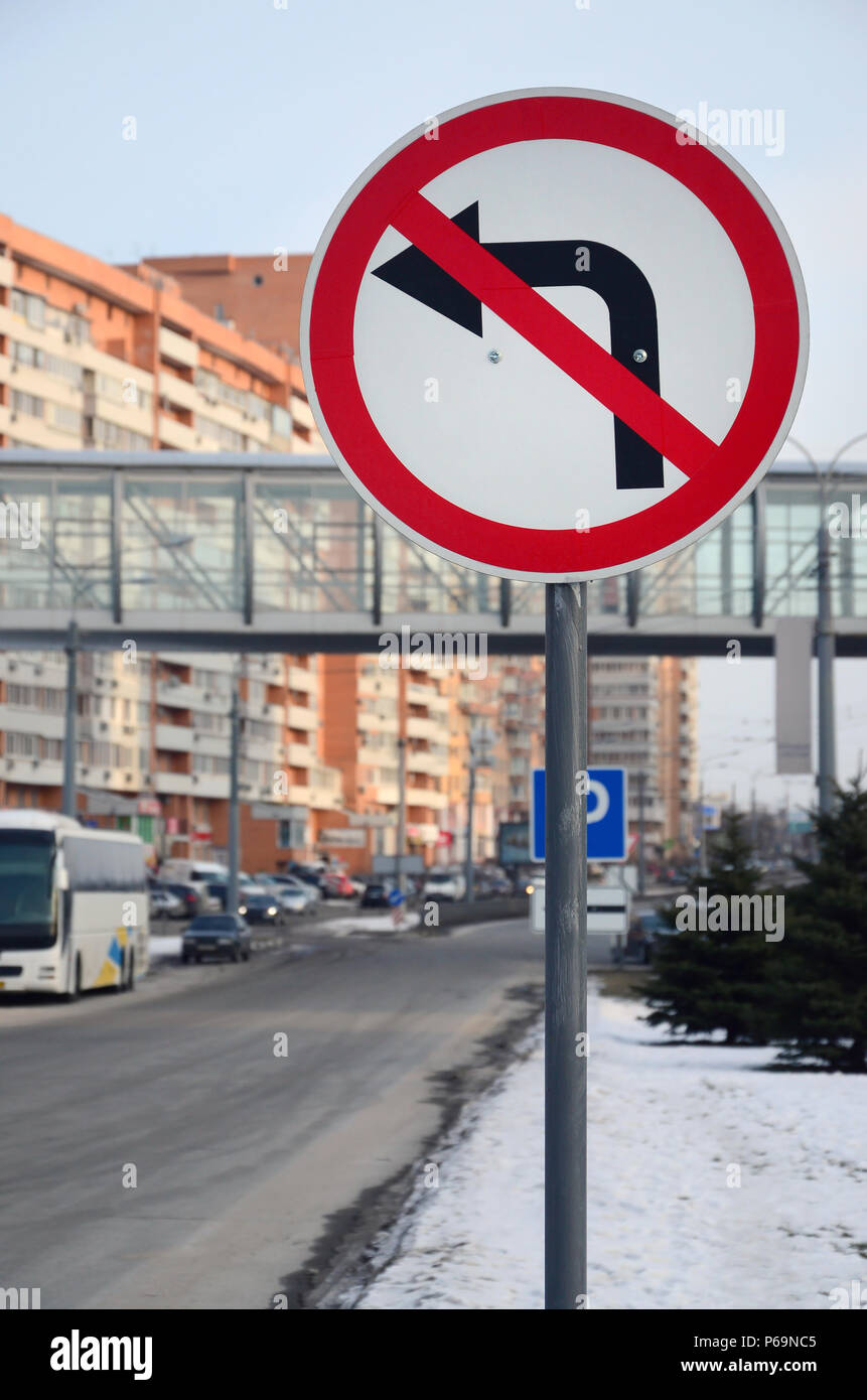 Turn left is prohibited. Traffic sign with crossed out arrow to the left . - Stock Image