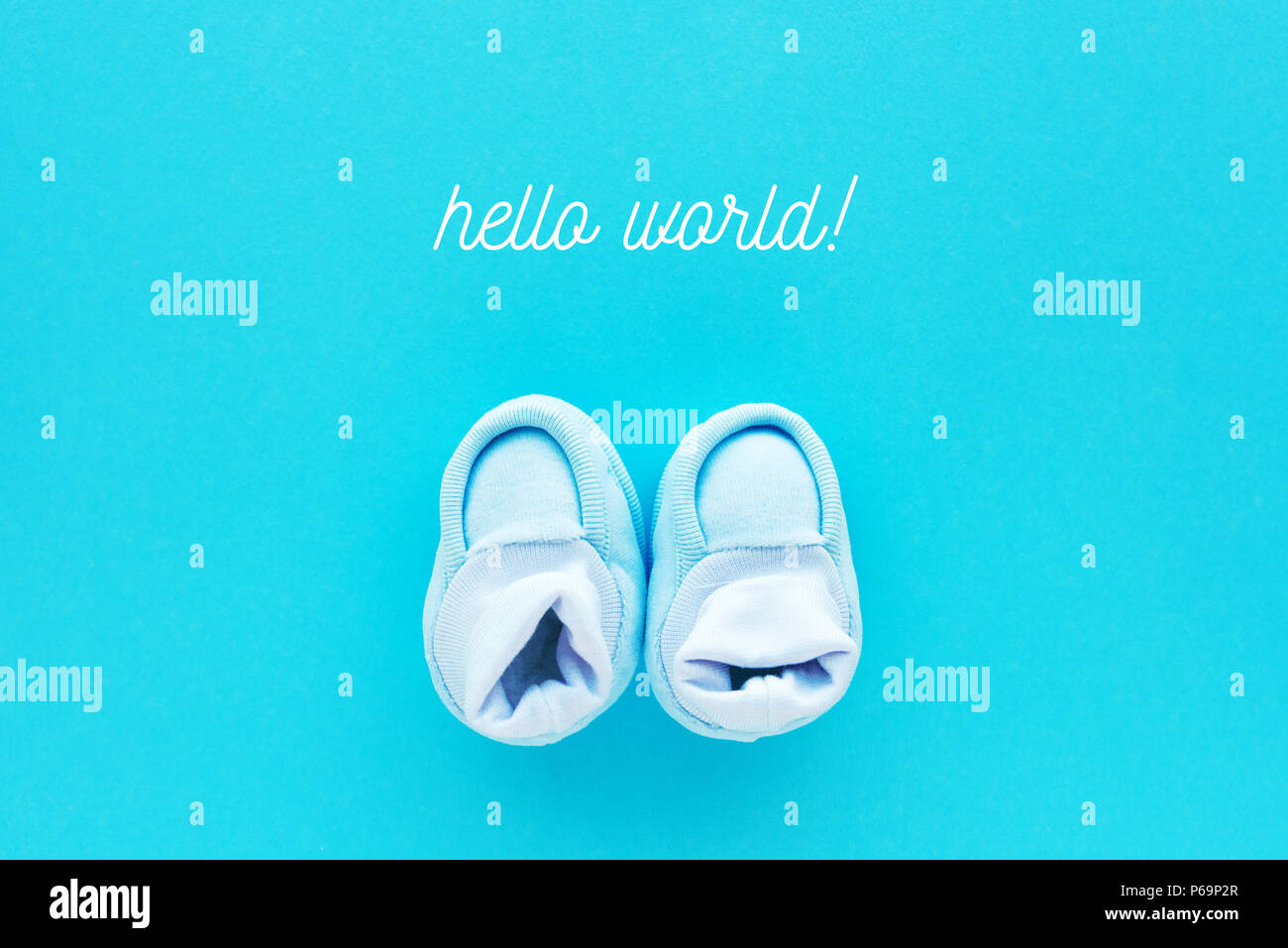 hello world message with small newborn baby boy cotton shoes viewed