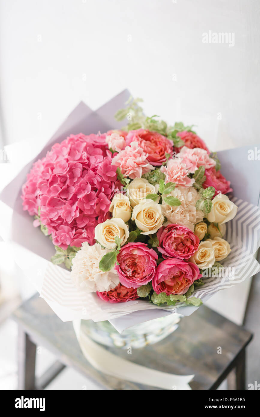Beautiful spring bouquet flower arrangement with hydrangea and beautiful spring bouquet flower arrangement with hydrangea and peonies roses color light pink the concept of a flower shop a small family business izmirmasajfo