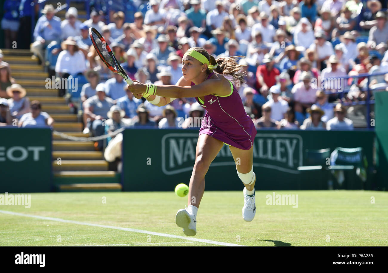 Aleksandra Krunic of Serbia plays a shot against Johanna Konta of Great Britain during the Nature Valley International tennis tournament at Devonshire Park in Eastbourne East Sussex UK. 26 June 2018 - Stock Image