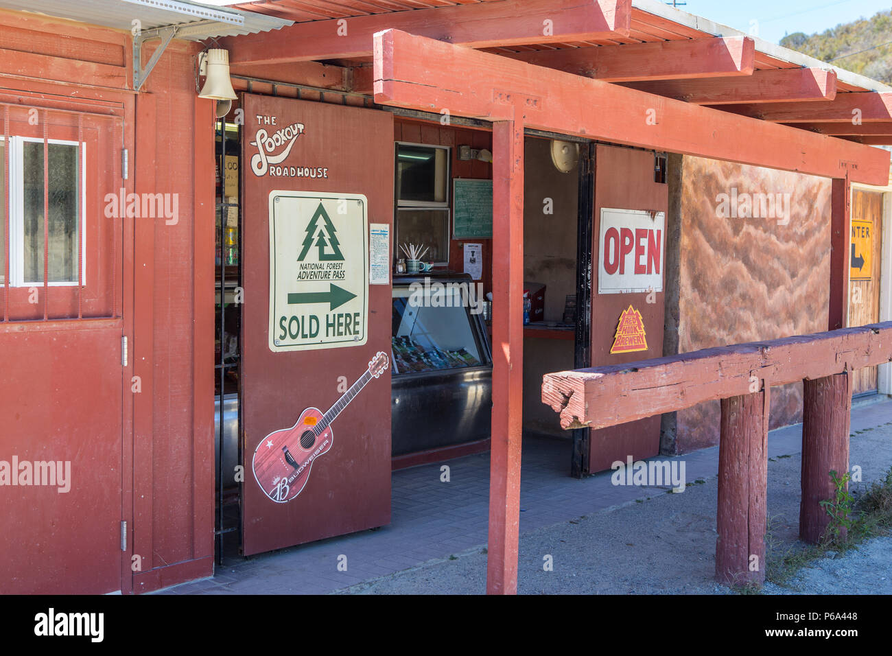 Lookout Roadhouse  on Ortega Hwy displaying the national forest adventure pass for sale  sign. Lake Elsinore California USA - Stock Image