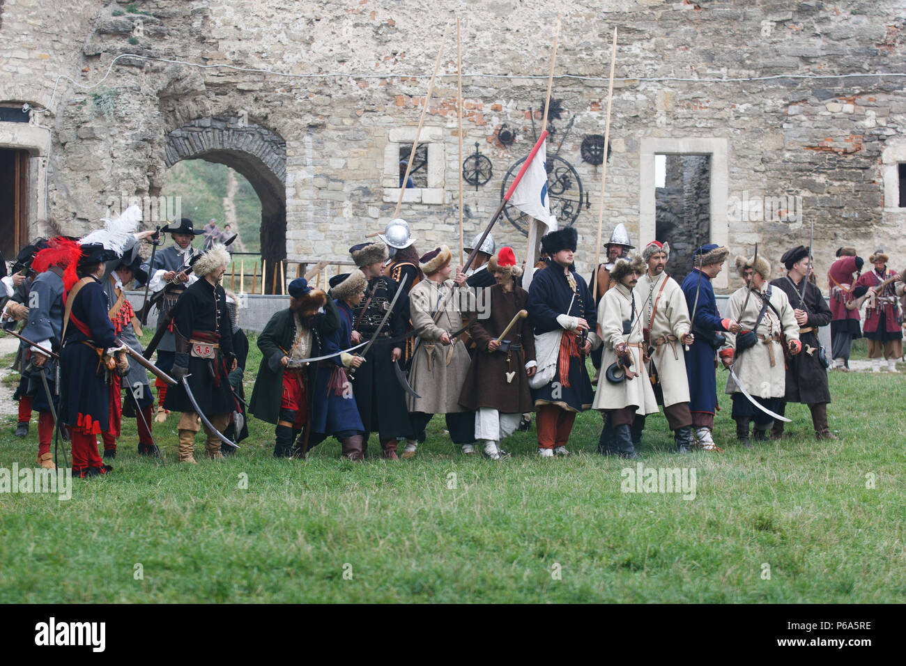 KAMYANETS-PODILSKY, UKRAINE - SEPTEMBER 26, 2010: Members of history club wear historical uniform 17 century during historical reenactment. The ukrain - Stock Image