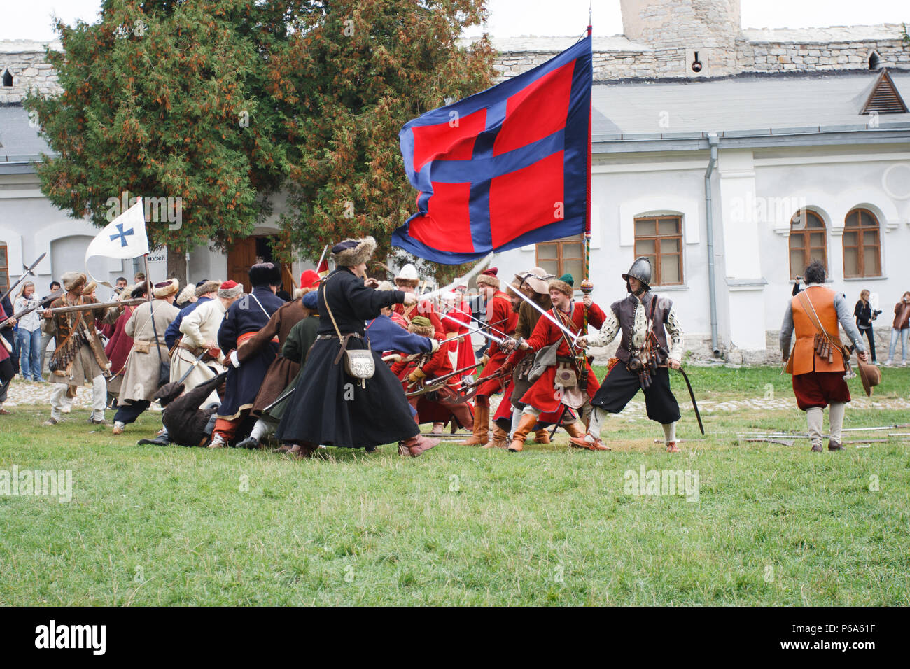 KAMYANETS-PODILSKY, UKRAINE - SEPTEMBER 26, 2010: Members of history club wear historical uniform 17 century during historical reenactment - Stock Image
