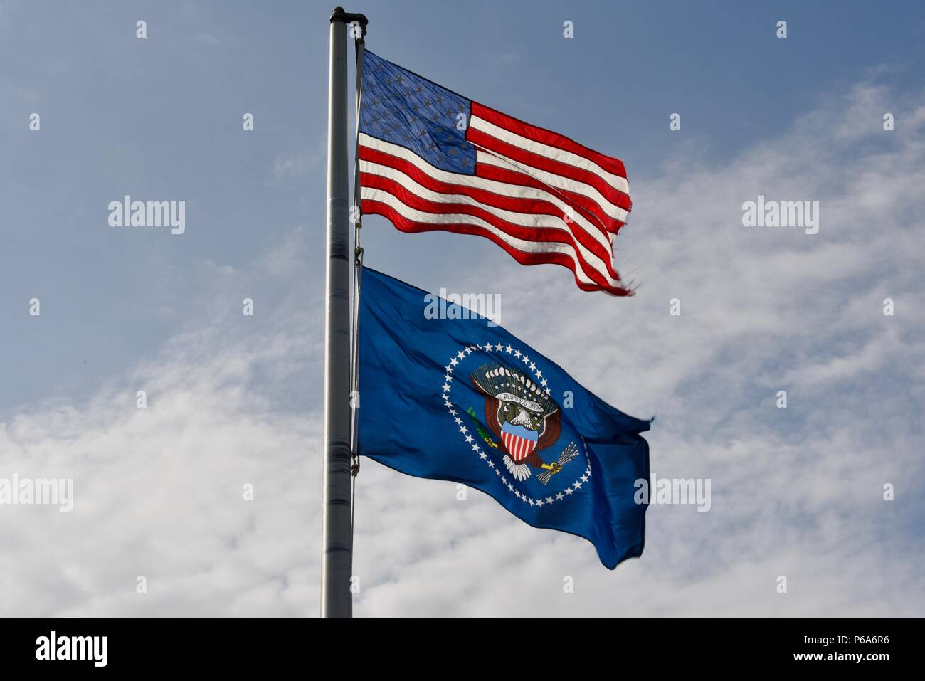 United States national & US Presidential flags, US, Presidential seal on the blue flag, flying over Lyndon B Johnson National Historical Park, TX USA Stock Photo