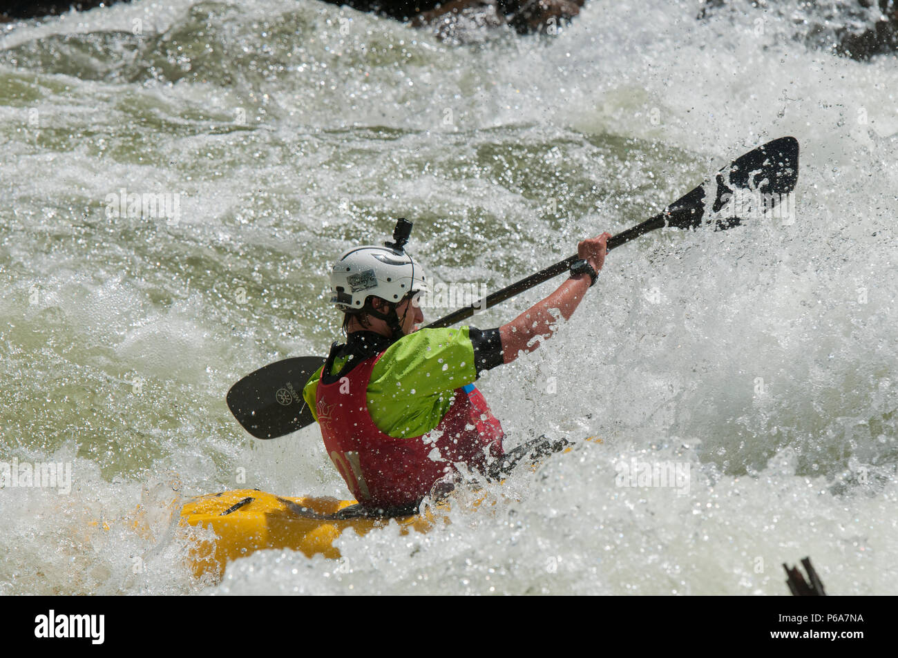 Kayaking on the North Fork Payette River in Jacobs Ladder class V rapid during the 2018 North Fork Championship - Stock Image