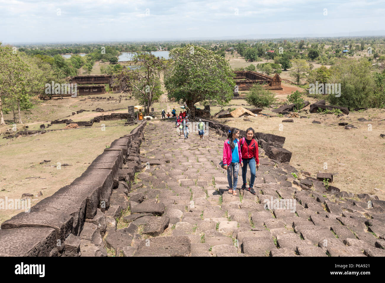 People ascending the walkway to the temple at Wat Pho (or Wat Phu) temple ruin UNESCO site, Champasak, Laos - Stock Image