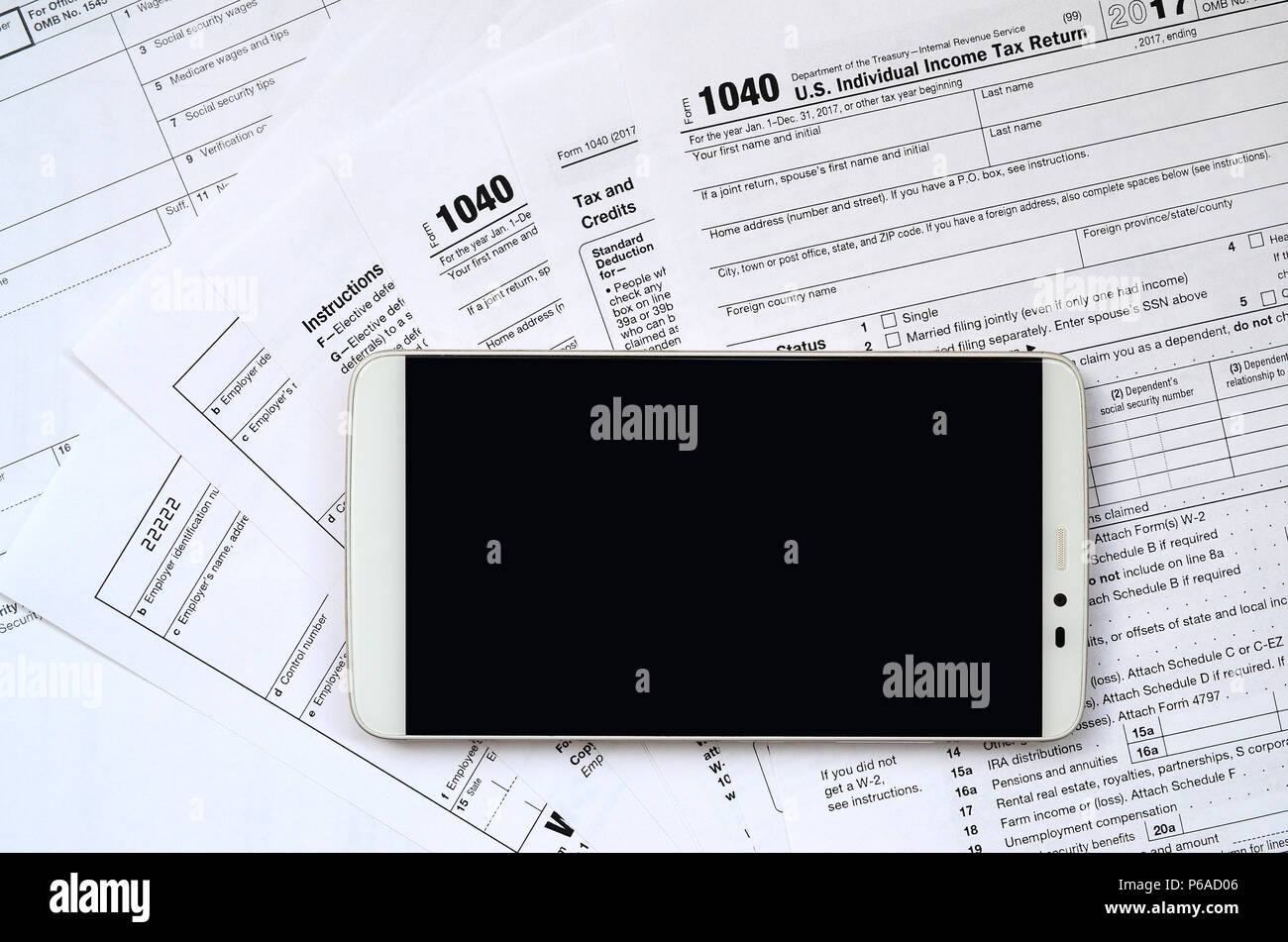 The Smartphone Lies On The Tax Form 1040 And W 2 Clean Black Screen