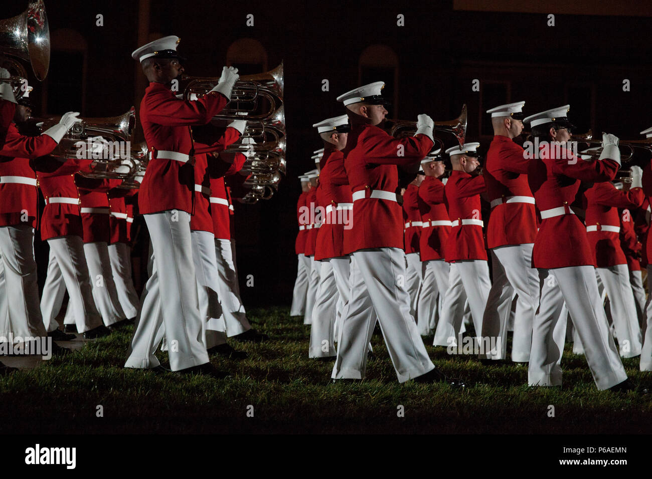 Members of the U.S. Marine Corps Drum and Bugle Corps perform during an evening parade at Marine Barracks Washington, Washington, D.C., April. 29, 2016. The guest of honor was Gen. Robert B. Neller, the 37th commandant of the Marine Corps, and the hosting official was Col. Benjamin T. Watson, commanding officer, Marines Barracks Washington. The evening parade summer tradition began in 1934 and features the Silent Drill Platoon, the U.S. Marine Band, the U.S. Marine Drum and Bugle Corps and two marching companies. More than 3,500 guests attend the parade every week. (U.S. Marine Corps photo by  Stock Photo