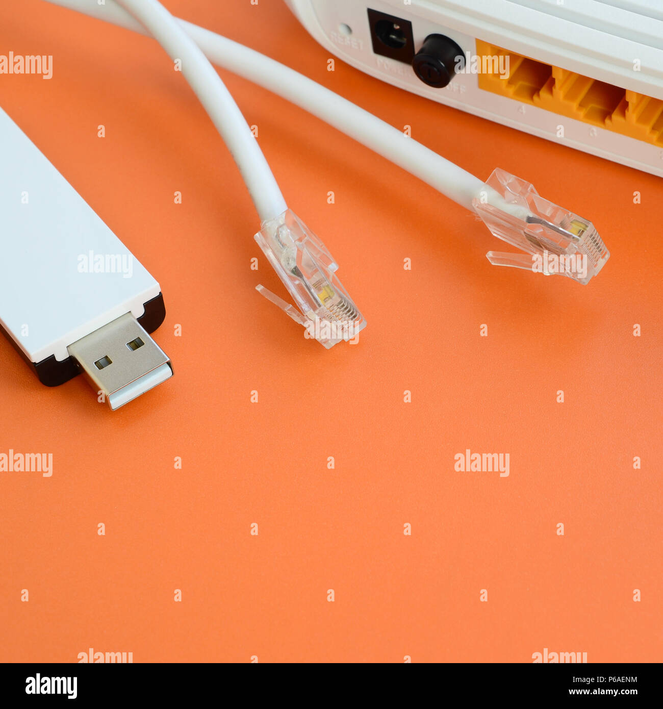 Internet Router Portable Usb Wi Fi Adapter And Cable Plugs Home Wiring Lie On A Bright Orange Background Items Required For Connection