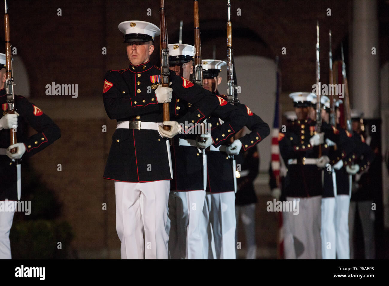 Members of the Silent Drill Platoon with Marine Barracks Washington (MBW) perform during an evening parade at MBW, Washington, D.C., April. 29, 2016. The guest of honor was Gen. Robert B. Neller, the 37th commandant of the Marine Corps, and the hosting official was Col. Benjamin T. Watson, commanding officer, Marines Barracks Washington. The evening parade summer tradition began in 1934 and features the Silent Drill Platoon, the U.S. Marine Band, the U.S. Marine Drum and Bugle Corps and two marching companies. More than 3,500 guests attend the parade every week. (U.S. Marine Corps photo by Lan Stock Photo