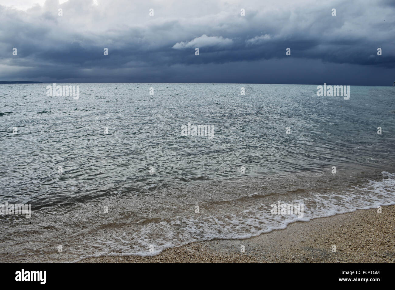 View from the beach at blue sea with little wave background - Stock Image