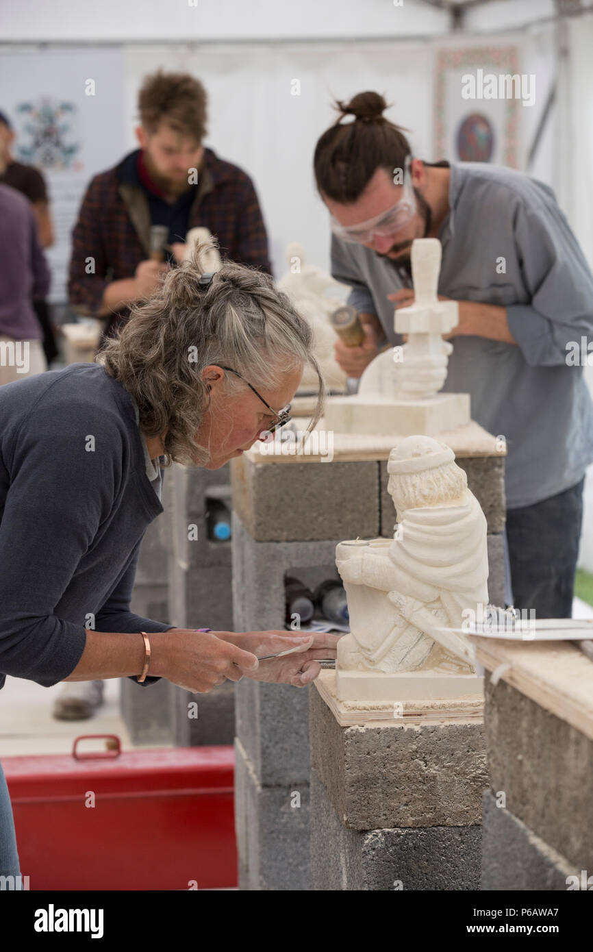 Winchester Cathedral Stone Festival. Masons from around the country will gather within the Inner Close of the Cathedral and carve sculptures, Hants UK - Stock Image