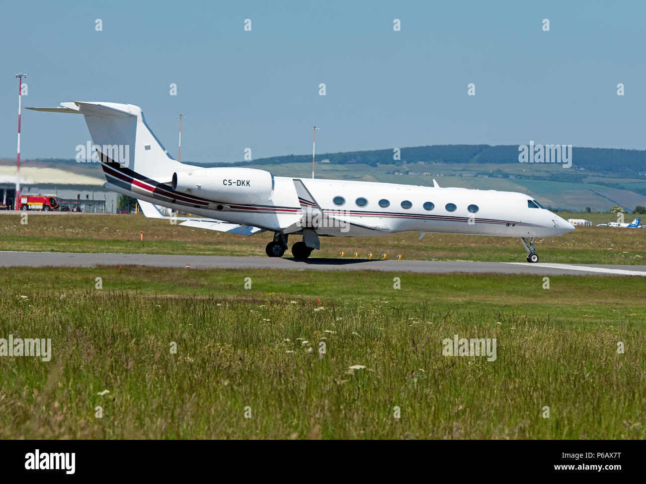 Gulfstream 550 twin engined Business Jet owned by Net Jets Europe Approaching/ Landing at Inverness Dalcross Airport in the Scottish Highlands. - Stock Image