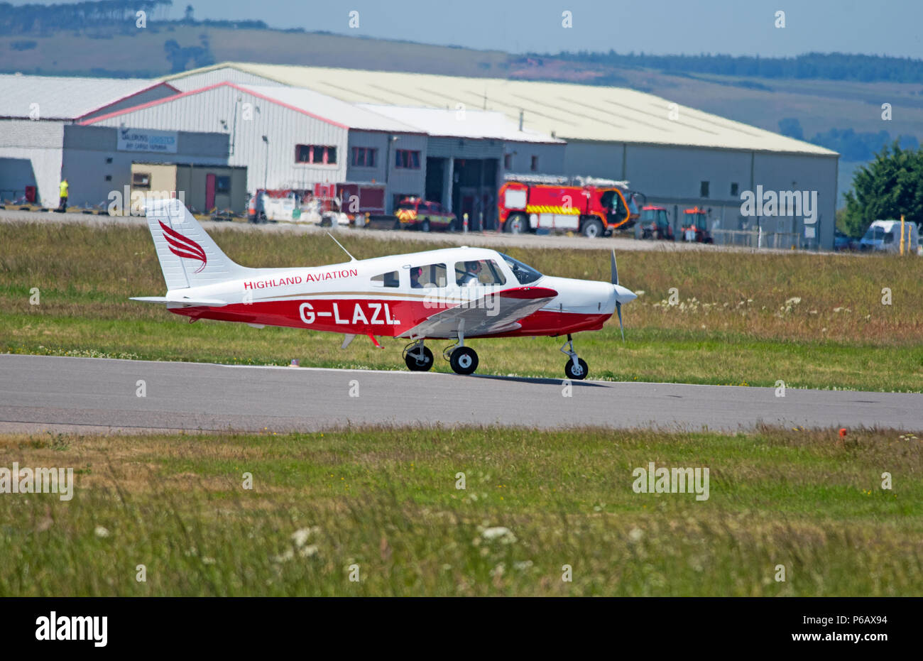 Piper PA -28-161 Cherokee Warrior ll at Inverness Dalcross airport during a flight training session. - Stock Image