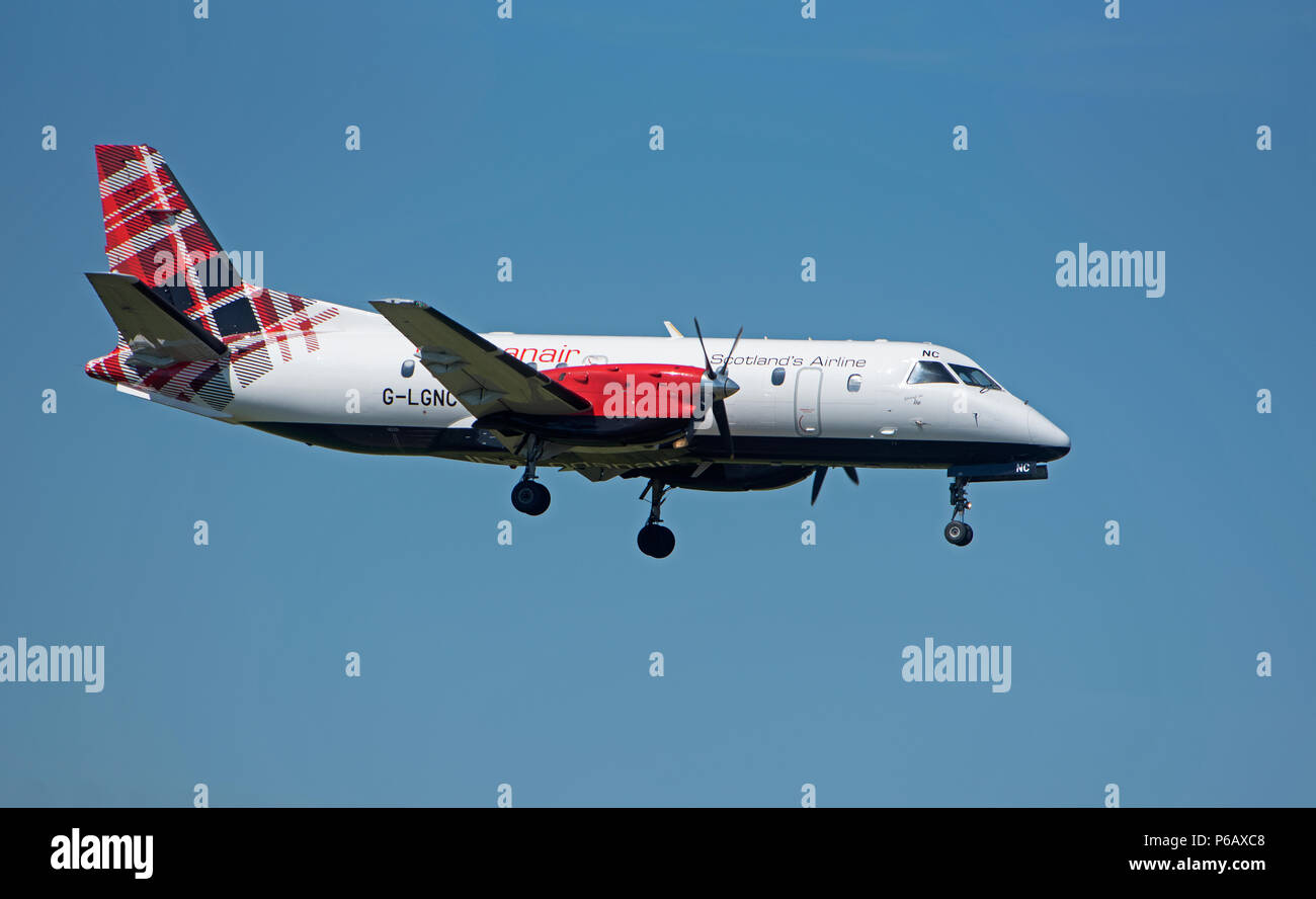 Loganair Saab 340 G-LGNC taking off from Inverness Airport on it's daily flight to Stornoway in the Outer Hebrides. Stock Photo