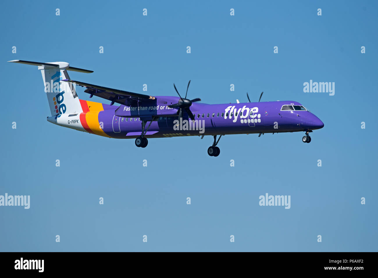 Flybe Dash 8 -400Q Passenger aircraft approaching Inverness airport in the Scottish Highlands ready for landing. - Stock Image