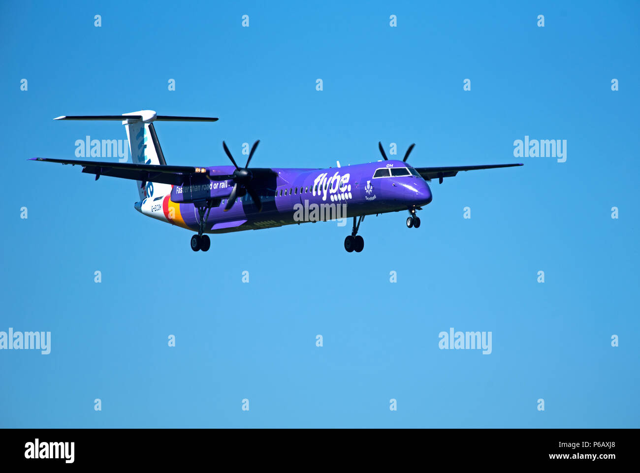 Flybe Dash 8 -400Q Passenger aircraftT approaching Inverness airport in the Scottish Highlands ready for landing. Stock Photo