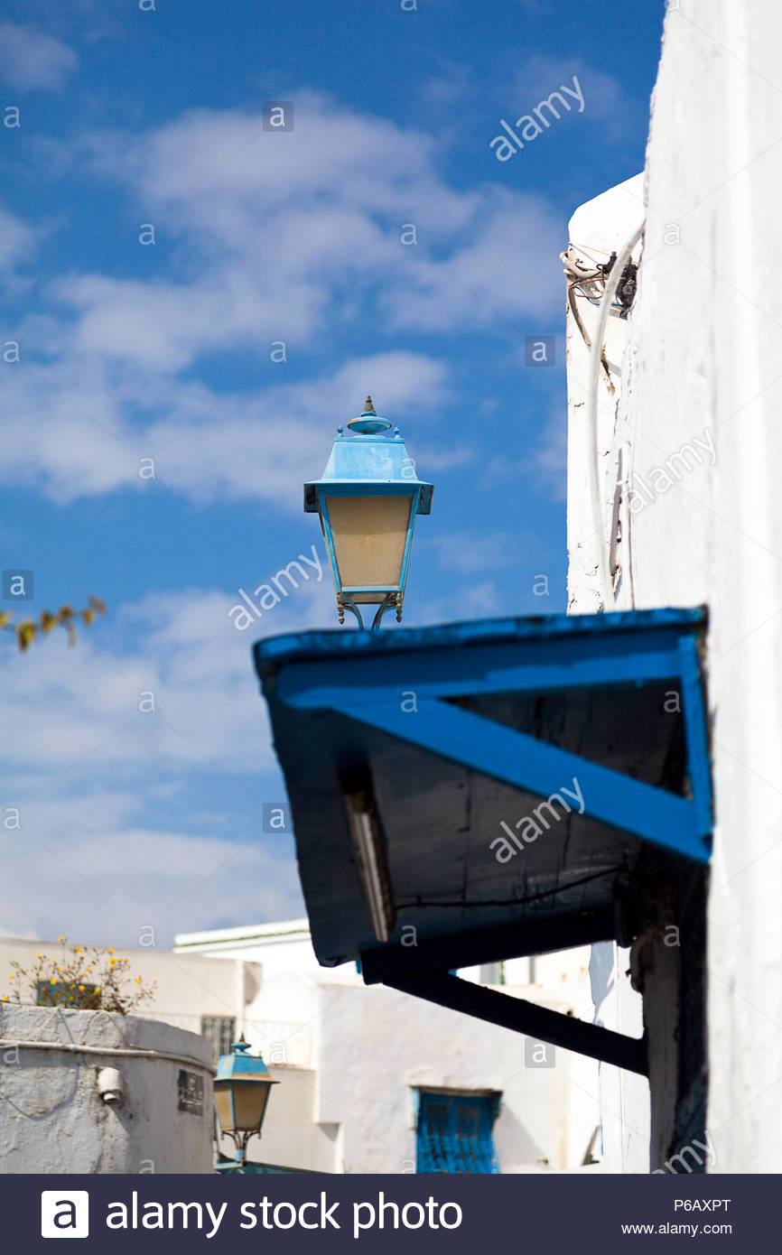 Blue lantern and canopy at the blue and white houses of Sidi Bou Said in Tunisia. Stock Photo