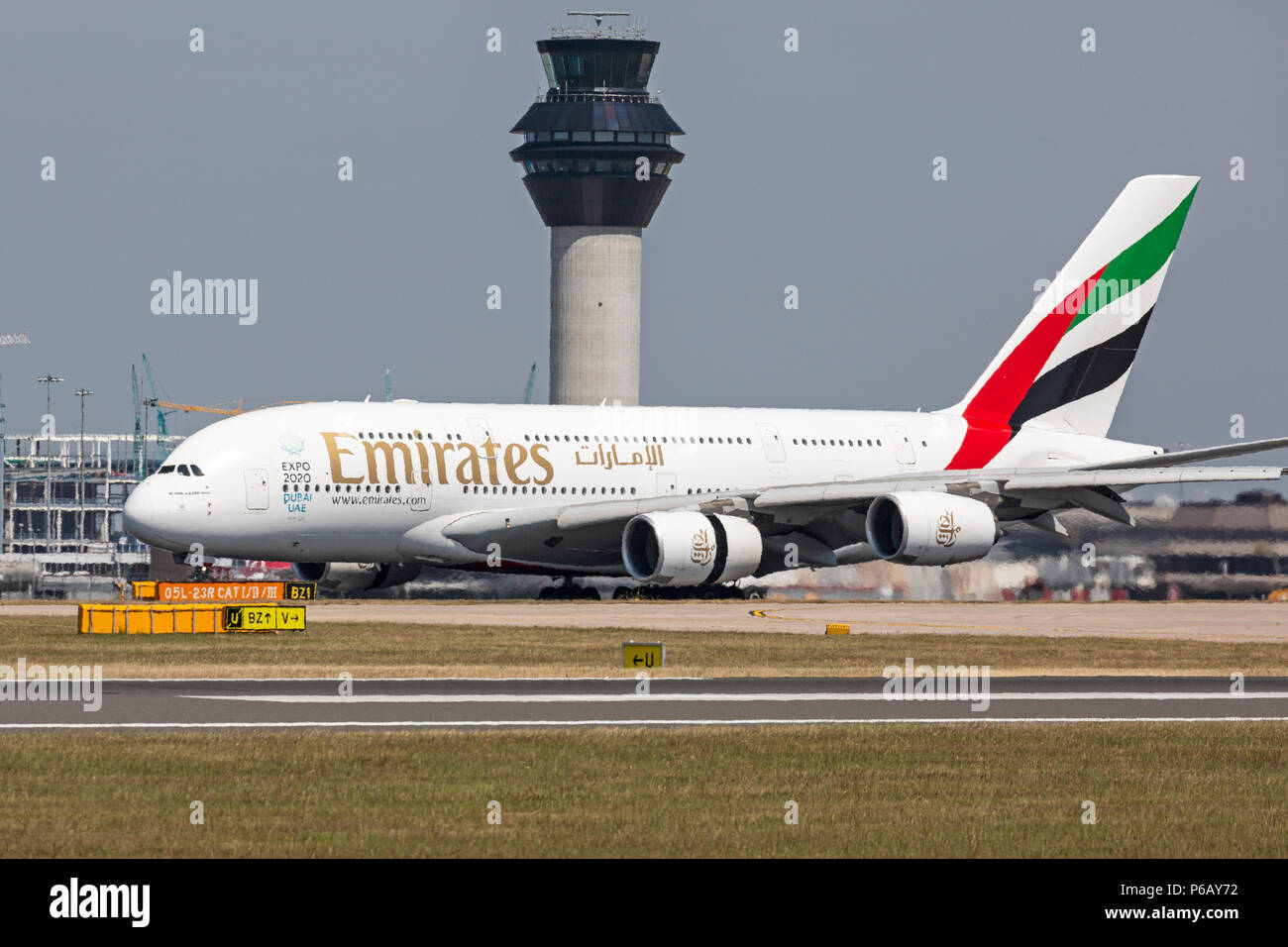 An Emirates Airlines Airbus A380 airliner, taking off from Manchester Airport in England. - Stock Image