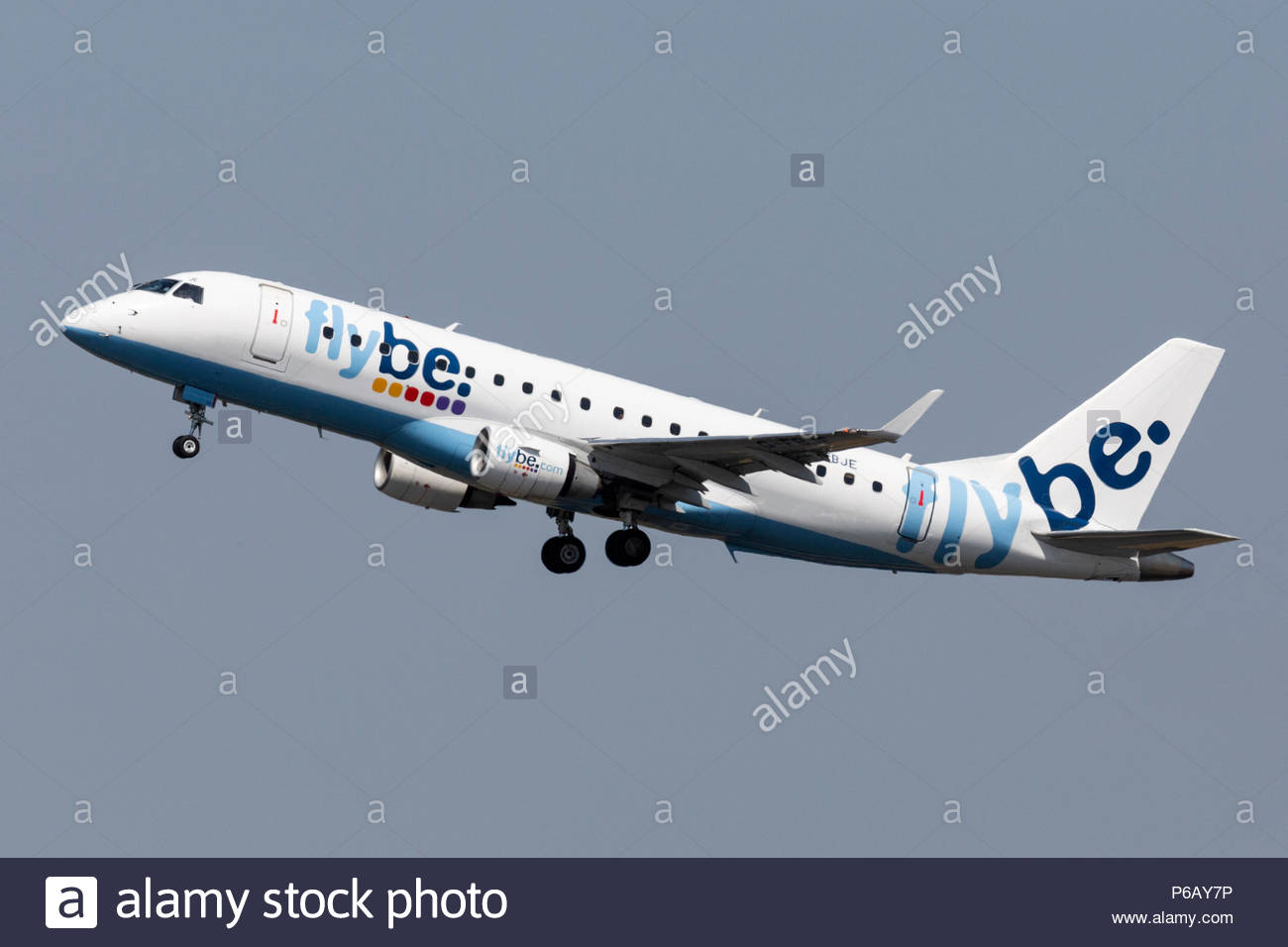 A Flybe Embraer EMB-175 airliner, G-FBJE, taking off from Manchester Airport in England. - Stock Image