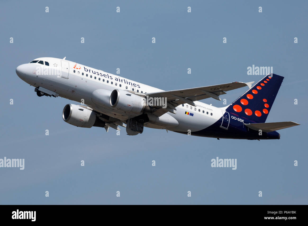 A Brussels Airlines Airbus A319, OO-SSK, taking off from Manchester Airport in England. - Stock Image