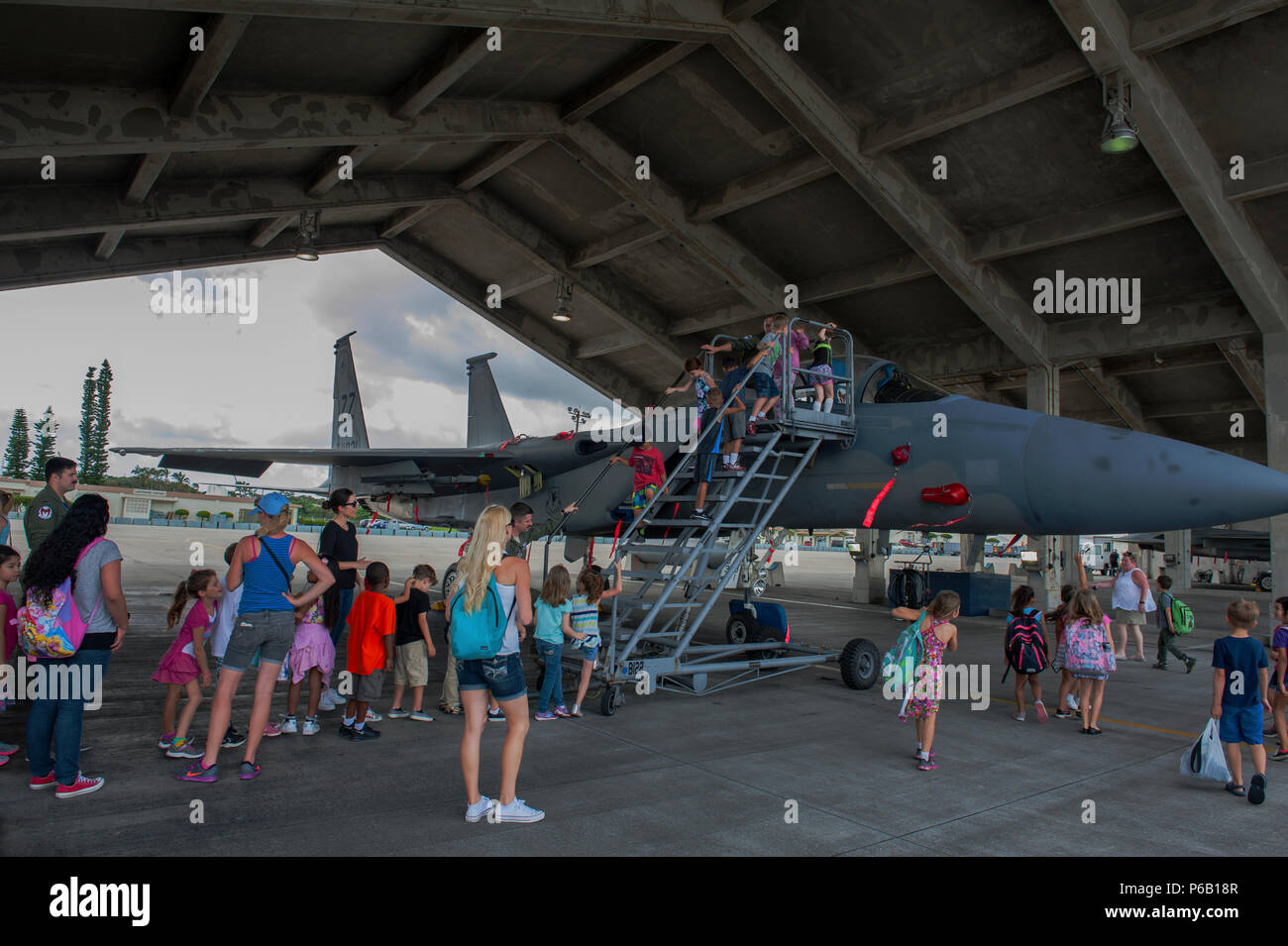 Students, parents, and staff from Bechtel Elementary School tour a 44th Fighter Squadron F-15 Eagle during a career day field trip May 16, 2016, at Kadena Air Base, Japan. The F-15 Eagle is an undefeated Mach 2 class tactical fighter that can travel at 1,875 mph.  (U.S. Air Force photo by Airman 1st Class Lynette M. Rolen) - Stock Image
