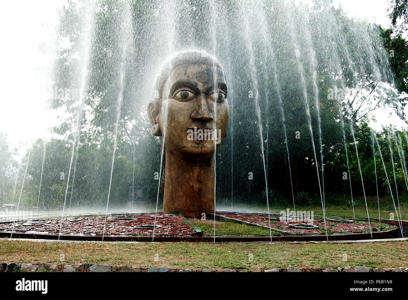 View of frightened eyes and forceful jets of fountain at Kannada University Campus in Hampi, Karnataka, India, Asia - Stock Image