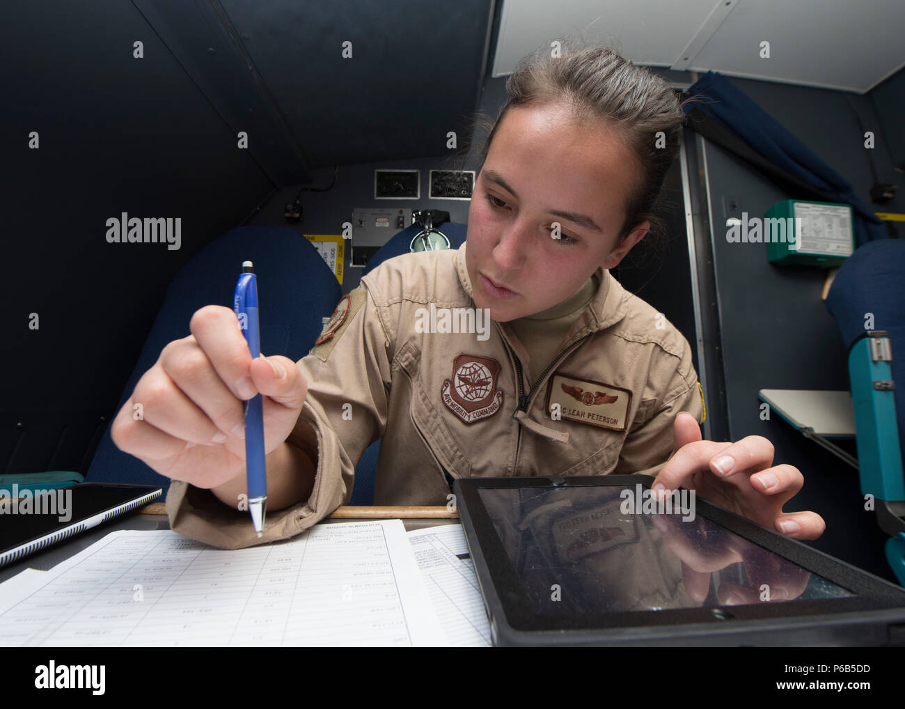 Airman 1st Class Leah Peterson, 9th Airlift Squadron loadmaster, goes over pre-flight procedures prior to take-off May 23, 2016, inside a C-5M Super Galaxy on Joint Base Pearl Harbor-Hickam, Hawaii. An 9th AS aircrew circumnavigated the globe in 14 days. (U.S. Air Force photo/Senior Airman Zachary Cacicia) - Stock Image
