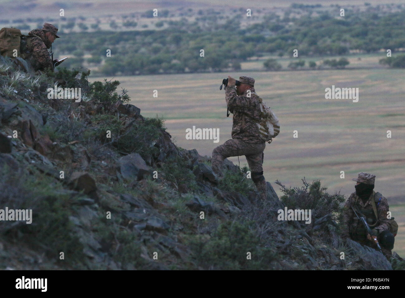 Mongolian Armed Forces pull security and watch for enemy