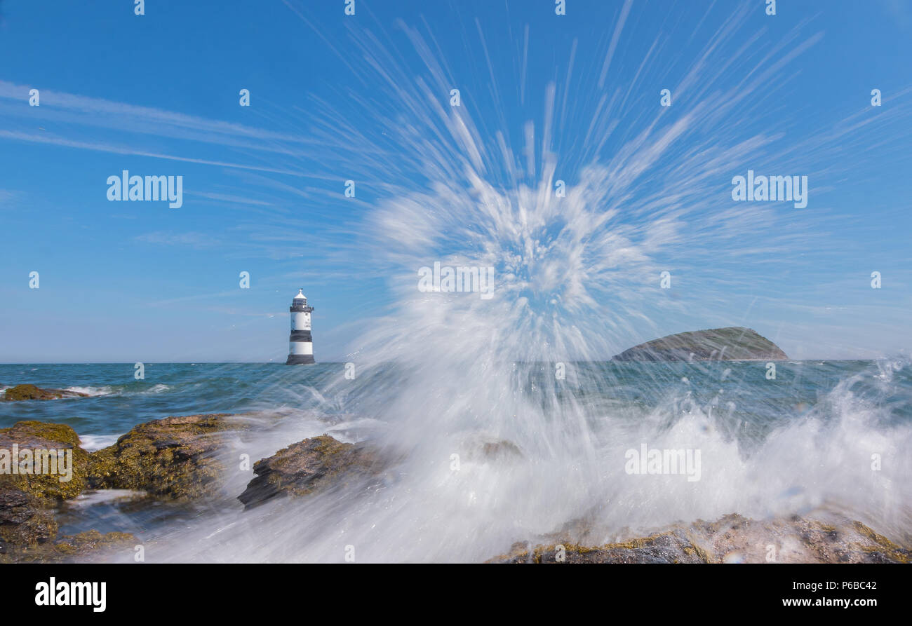 Wave breaking at Penmon Point, Anglesey - Stock Image