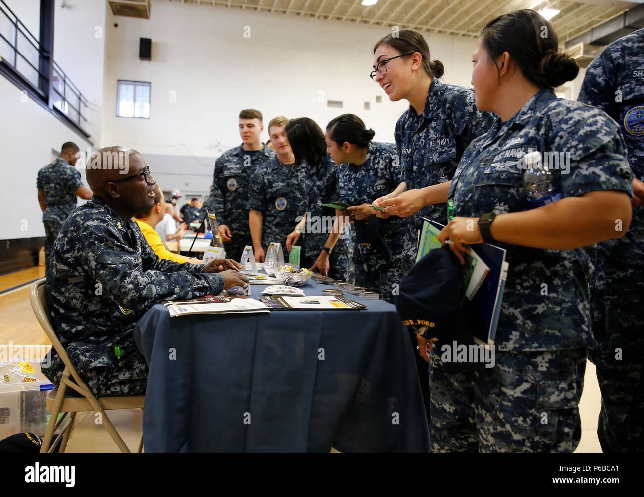 NEWPORT NEWS, Va. (May 26, 2016) --  Sailors assigned to Pre-Commissioning Unit Gerald R. Ford (CVN 78) take pamphlets of safe drinking habits apart of the 'Keep What You've Earned' campaign during Ford's Summer Safety Expo at Huntington Hall. The expo coincided with Navy Safety Center's 101 Critical Days of Summer campaign, which raises awareness of possible off-duty mishaps during the summer months. (U.S. Navy photo by Mass Communication Specialist Seaman Apprentice Gitte Schirrmacher/Released) - Stock Image