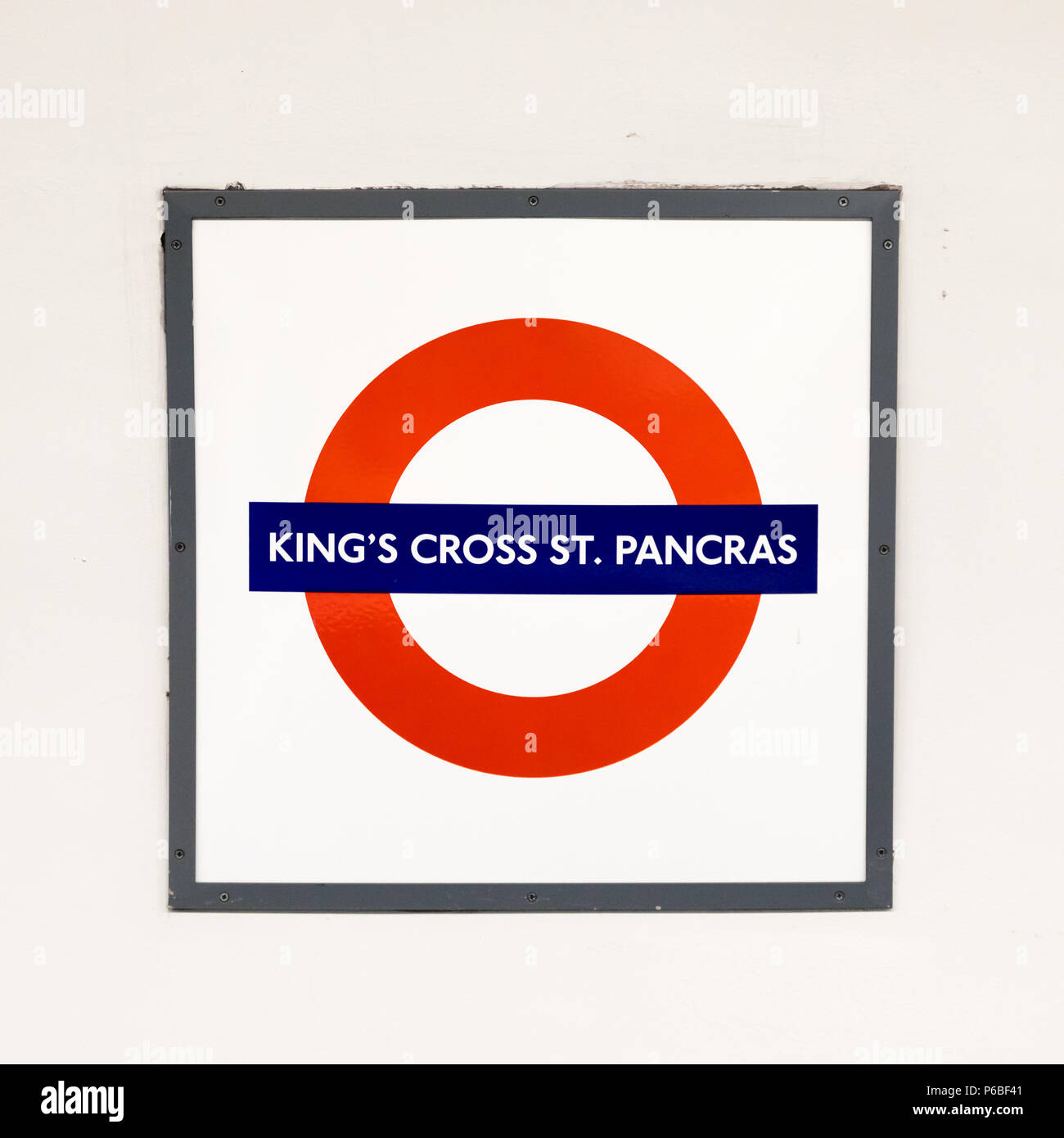 London, UK - 6th June 2017: Kings Cross St. Pancras underground sign on the wall in the tube station. Iconic London emblem for the Underground trains  - Stock Image