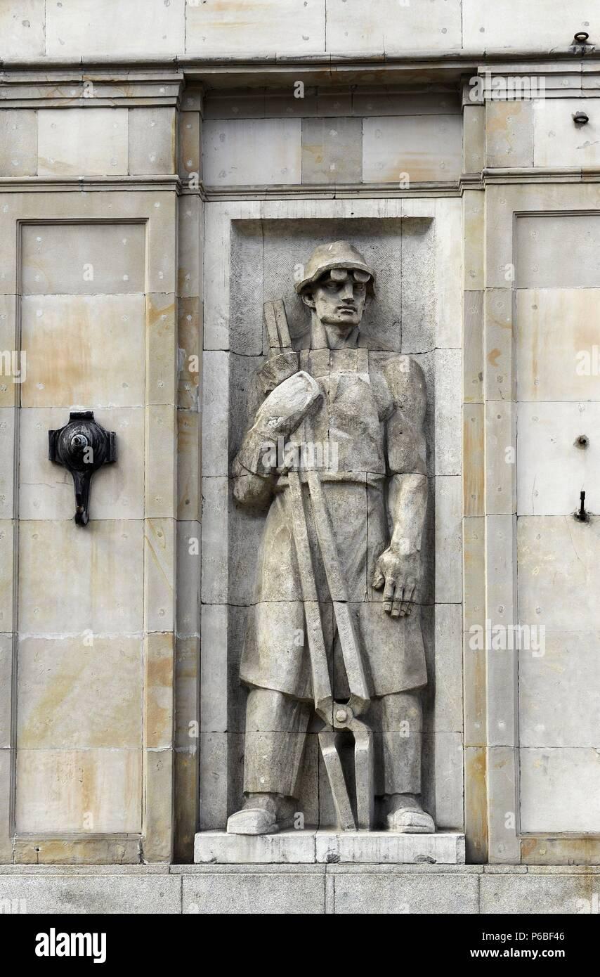 Poland. Warsaw. Socialist relief. Constitution Square. Stock Photo