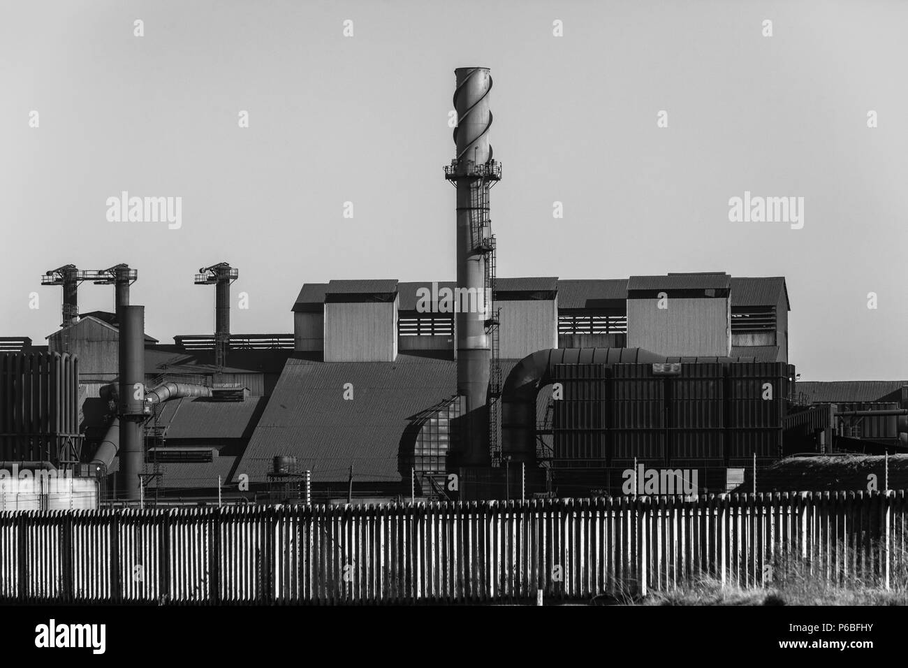 Factory structure industrial raw materials production  outdoors vintage black and white photo. - Stock Image