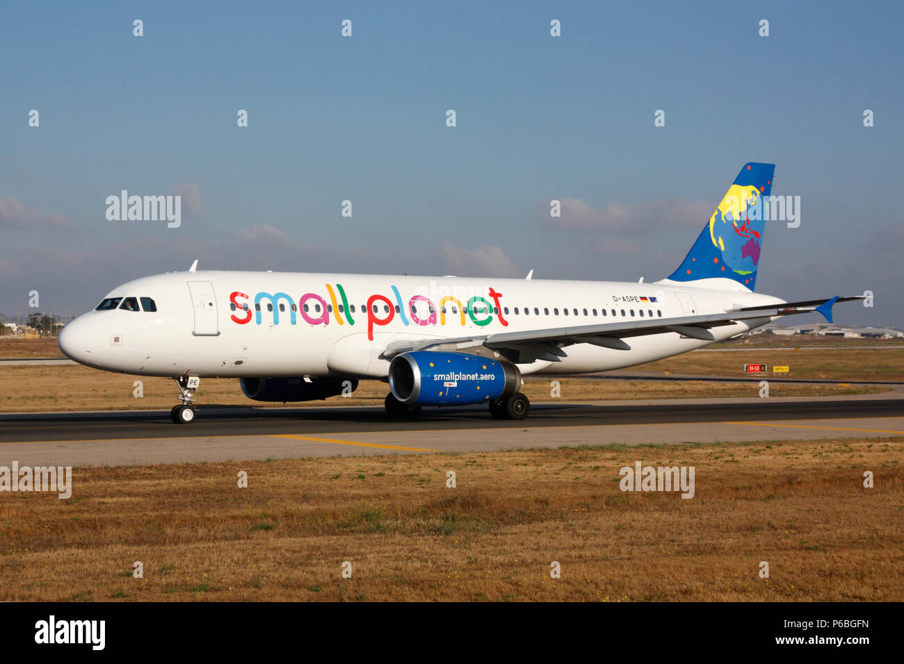Airbus A320 passenger jet belonging to Lithuanian airline Small Planet Airlines taxiing for departure from Malta. Air travel in the European Union. - Stock Image