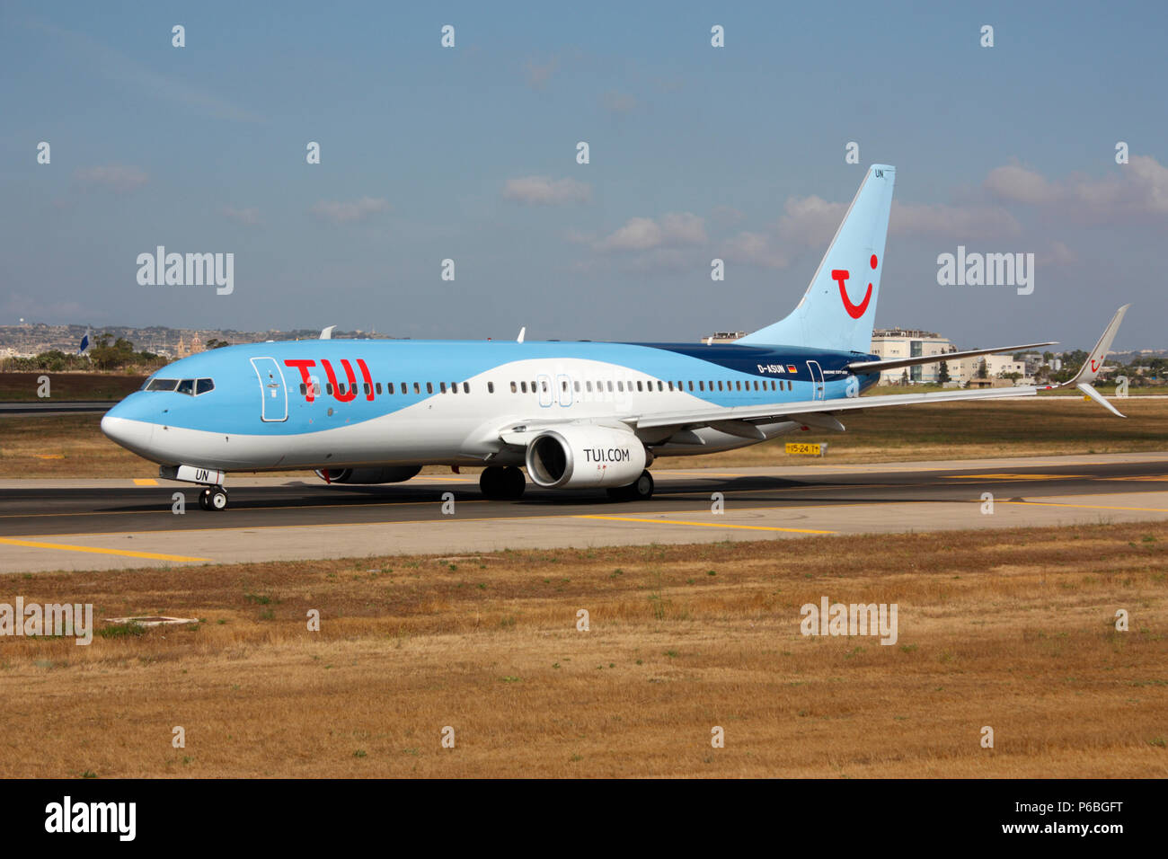 TUI Airways Boeing 737-800 passenger jet plane taxiing for departure from Malta. Modern commercial aviation. - Stock Image