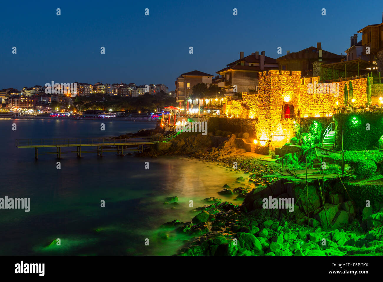 Night photo of reconstructed gate part of Sozopol ancient fortifications, Bulgaria - Stock Image