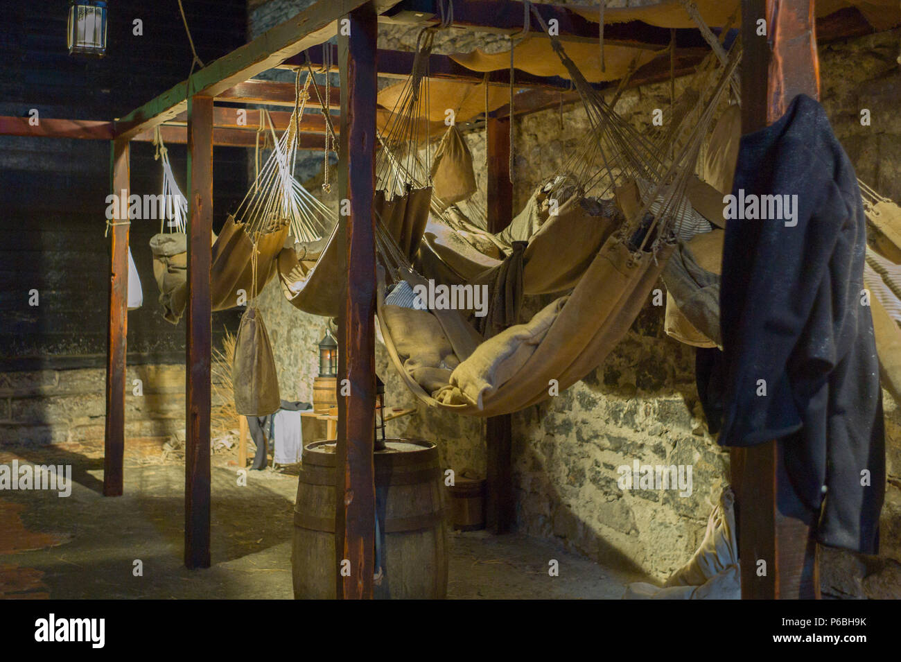 Hammocks hanging in the prison inside Edinburgh Castle used by prisoners of war. Scotland - Stock Image