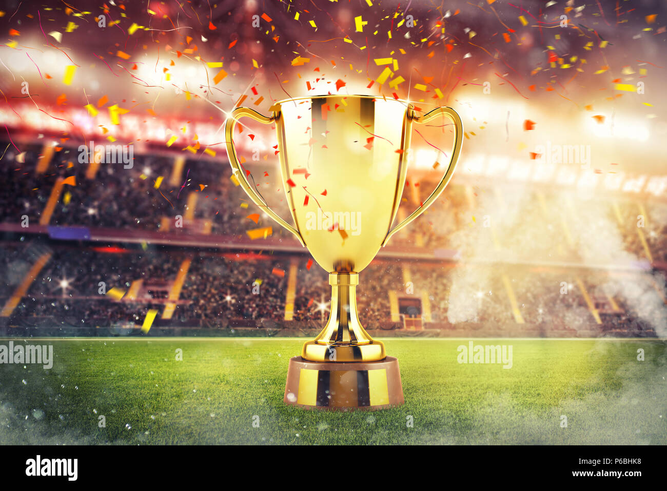 Golden winner's cup in the middle of a stadium with audience - Stock Image