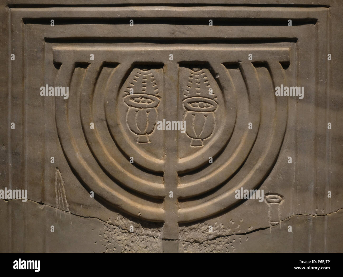 The Jewish Menorah carved in remain of the ancient synagogue (4-9th centuries CE) of Susya or Susiya archaeological site located in the southern Judea displayed at the Archeology Wing of the Israel Museum in West Jerusalem Israel - Stock Image
